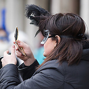VENICE, ITALY - FEBRUARY 11:  A woman wearing a Carnival mask checks in a mirror her make up on February 11, 2012 in Venice, Italy.The annual festival, which lasts nearly three weeks, will see the streets and canals of Venice filled with people wearing highly-decorative and imaginative carnival costumes and masks.