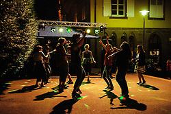 Late night dancing in the open air during Bastille day celebrations in the village of Neuwiller-les-Saverne, Alsace France.<br /> <br /> (c) Andrew Wilson   Edinburgh Elite media