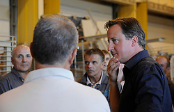 STRICT EMBARGO UNTIL 1800HRS 04 JULY 2011© Licensed to London News Pictures. 04/07/2011. British Prime Minister David Cameron visits ISAF personnel in Camp Bastion, Afghanistan today (4 Jul 11).  The PM not only met with British and US troops but he also took time in his schedule to meet some of the civilian employess from the Defence Support Group who help to keep some of the many military vehicles in service. See special instructions. Mandatory Photo credit : Sergeant Alison Baskerville/LNP