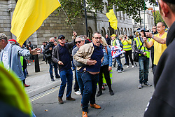 "© Licensed to London News Pictures. 07/09/2019. London, UK. Pro Brexit protester demonstrates in Whitehall as anti-Brexit protesters take part in ""Defend our Democracy and Stop Brexit"" demonstration in Whitehall, Westminster. The protesters are demonstrating against the British Prime Minister Boris Johnson's intention to prorogue Parliament until 14 October. Photo credit: Dinendra Haria/LNP"
