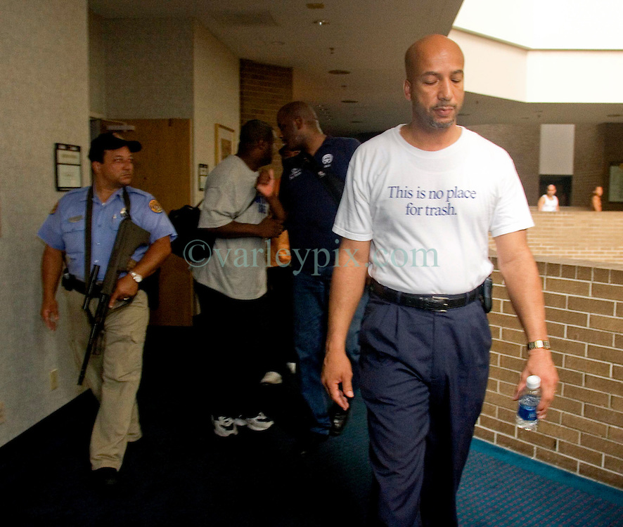 1st Sept, 2005. Mayor Ray Nagin looking stressed at the Hyatt Hotel in New Orleans as he is escorted to his HQ.