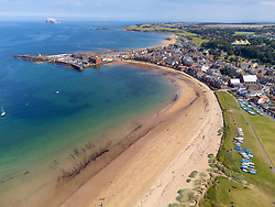 Aerial view from drone of seafront and West Bay beach at North Berwick in East Lothian, Scotland, UK