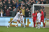 Andre Ayew of Swansea city celebrates after he scores his teams 3rd goal.  Barclays Premier league match, Swansea city v Liverpool  at the Liberty Stadium in Swansea, South Wales on Sunday 1st May 2016.<br /> pic by  Andrew Orchard, Andrew Orchard sports photography.
