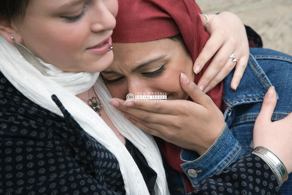 Young woman comforting her upset friend,