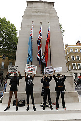 © Licensed to London News Pictures. 03/06/2020. London, UK. Members of the campaign group Black Lives Matter and supporters, protest on the Cenotaph in central London to demonstrate, following the death of African American George Floyd while in police custody. The death of George Floyd, who died after being restrained by a police officer In Minneapolis, Minnesota, has caused widespread rioting and looting across the USA. Photo credit: Peter Macdiarmid/LNP