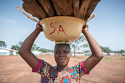5 June 2019, Gado, Cameroon: CAR refugee Nazariah carries firewood to her home in the Gado refugee camp. Supported by the Lutheran World Federation, the Gado refugee camp in he East region of Cameroon hosts more than 25,000 refugees from neighbouring Central African Republic.