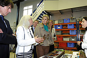 """31-01-2013 Arnhem Princess Maxima visited a workshop of the probation in Arnhem.<br /> People with a community service refurbish used tools, which are collected by the foundation """"Gered Gereedschap"""" (save tools) for students of technical education in developing countries. ANP ROYAL IMAGES COPYRIGHT HENDRIK JAN VAN BEEK"""