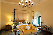 Guest room at Monasterio Hotel, a 16th century Spanish colonial Palace, Cusco, Peru, South America