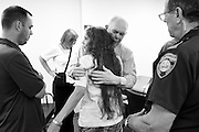 After pleading guilty to aggravated felonious sexual assault against a girl under 13, Curtis Wyman, of Cornish, is given a moment to say goodbye to his wife Diana, middle, son Curtis Jr., left, and sister, back left, before being escorted out of Sullivan County Superior Court by Sheriff's Deputy William Ball, right, Monday, August 3, 2015. Wyman was sentenced to six-and-a-half to 15 years in prison. (Valley News - James M. Patterson)<br /> Copyright © Valley News. May not be reprinted or used online without permission. Send requests to permission@vnews.com.