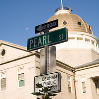 Pearl Street sign in front of the Court House in Dedham, MA