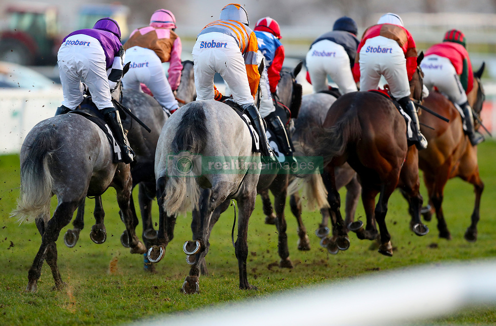 Runners and riders compete in the Book For Easter Now Conditional Jockeys Mares Handicap Hurdle during Injured Jockeys Fund Charity Raceday at Plumpton Racecourse.