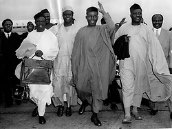 Sep 19, 1958; London, UK; Chief OBAFEMI AWOLOWO, Premier of Western Nigeria, received a traditional welcome from students when he arrived at London Airport this morning. He is to attend the rresumed Nigerian Constitutional Conference at Lancaster House. The picture shows Chief Awolowo acknowledging the greeting of the rreception committee, on his arrival at London airport this morning. (Credit Image: © Keystone Press Agency/Keystone USA via ZUMAPRESS.com)