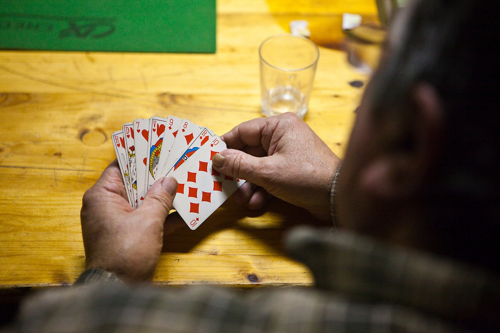 Members of the village's hunting association play cards at their headquarters after a successful hunt in Barnave, Drôme valley, France.