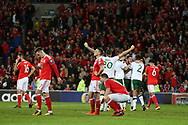 Rep of Ireland players celebrate their win as Wales players stand and can't bear to look as they are dejected at final whistle after losing the match and their world cup dream is over. Wales v Rep of Ireland , FIFA World Cup qualifier , European group D match at the Cardiff city Stadium in Cardiff , South Wales on Monday 9th October 2017. pic by Andrew Orchard, Andrew Orchard sports photography