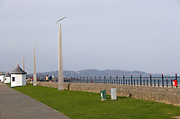 Victorian kiosks beside modern lamp posts on the seafront in wintertime at the seaside town of Bray in Wicklow Ireland