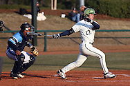 CARY, NC - MARCH 04: Notre Dame's Nick Neville (13) hits Rhode Island's Martin Figueroa (left) in the side of the head on his follow through. The University of Rhode Island Rams played the University of Notre Dame Fighting Irish on March 4, 2017, at USA Baseball NTC Field 3 in Cary, NC in a Division I College Baseball game, and part of the Irish Classic tournament. Notre Dame won the game 8-4.