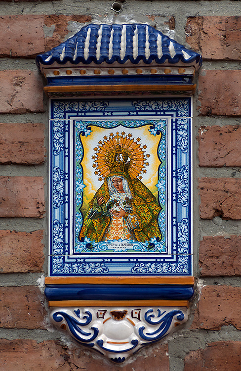Ceramic plaque of La Macarena, the patron of the matadors, hangs inside La Macarena Stadium in Medellin.