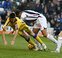 Photo: Mark Stephenson.<br />West Bromwich Albion v Southampton. Coca Cola Championship. 10/02/2007. Southampton's Grzegorz Rasiak (L) Is tackled by West Brom's Curtis Davies