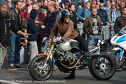 The pit area at the Essenza 1/8 mile sprints, which pitted DIY mechanics, hobby racers and small race teams against each other using many brands of bikes at the Intermot Motorcycle Trade Fair. Cologne, Germany. Saturday October 8, 2016. Photography ©2016 Michael Lichter.