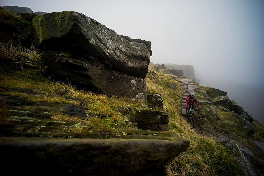 Nic Kidd, at home on gritsone descents, Peak District, England.