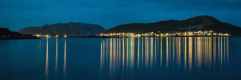The island Remøy, on the vestern part of Norway by night, with the Remøy Bridge in the middle of the picture. Panorama stiched by two exposures   Remøy i Herøy kommune i natten, med Remøybrua i midten av bildet. Panorama sett sammen av to eksponeringer.