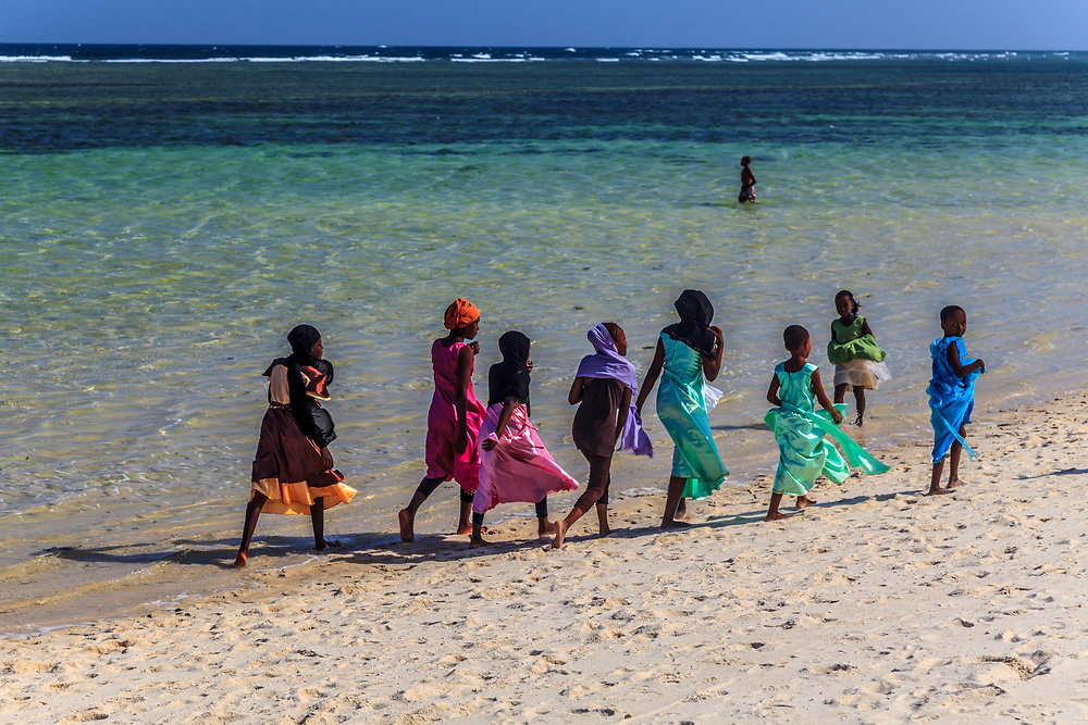 People enjoy the sun and the sea at Tiwi Beach in Kenya.