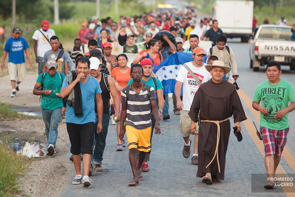 """Central American migrants have to make deadly, irregular and clandestine travels hidden in the wagons and gonads of the train through Mexico during weeks to arrive to the U.S.  The train is nicknamed """"La Bestia"""" (The Beast) due to its dangerousness.<br /> <br /> Each Holly Week, along with Mexican human rights activists, make religious and protest activities during the """"Viacrucis del migrante"""". <br /> <br /> This year, they walk on foot, since the evening of Thursday April 17th, after the train where they travel, under Ferrocarriles del Istmo enterprise orders, unhooked the gonads with people and left them abandoned in Tenosique. After being left, they made the decision to continue their way on foot. <br /> <br /> They have traveled on foot more than 100 km (328 000 ft) from Tenosique, Tabasco demanding an end to the violence against migrants and free transit through Mexico. (Photo credit: Prometeo Lucero)"""