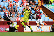 Richie Smallwood of Rotherham Utd (l) holds off Ashley Westwood of Aston Villa (r). EFL Skybet championship match, Aston Villa v Rotherham Utd at Villa Park in Birmingham, The Midlands on Saturday 13th August 2016.<br /> pic by Andrew Orchard, Andrew Orchard sports photography.