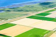 Nederland, Groningen, Gemeente  De Marne, 05-08-2014; Zevenboerenpolder en Julianapolder, onstaan door de inpoldering van de nabijgelegen kwelders van de Waddenzee. Landaanwinning Lutjewad.<br /> Polders, reclaimed from the nearby Wadden Sea.<br /> <br /> luchtfoto (toeslag op standard tarieven);<br /> aerial photo (additional fee required);<br /> copyright foto/photo Siebe Swart