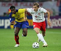 Gelsenkirchen 9/6/2006 World Cup 2006<br /> <br /> Poland Ecuador - Polonia Ecuador 0-2<br /> <br /> Photo Andrea Staccioli Graffitipress<br /> <br /> Marcin Baszczynski Poland Carlos Tenorio Ecuador