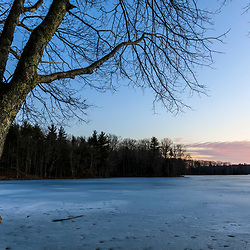 Dawn on the frozen Bellamy Reservoir in Madbury, New Hampshire.