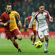 Galatasaray's Caglar BIRINCI (L) and Gaziantepspor's Ismael SOSA (R) during their Turkey Cup Quarter final matchday 2 Galatasaray between Gasiantepspor at the AliSamiYen Turk Telekom Arena in Istanbul Turkey on Wednesday 02 March 2011. Photo by TURKPIX