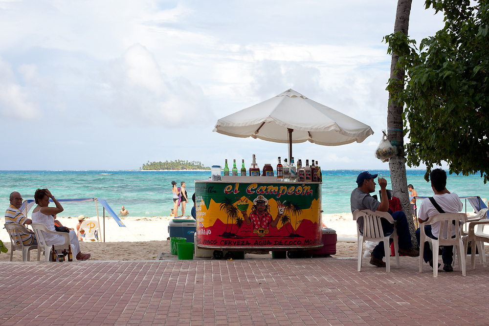 San Andres Island, Colombia - South America - People at a beach stand selling drinks in the main beach of the island.
