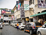 10 JUNE 2014 - YANGON, MYANMAR:   A row of fashion houses in Bogyoke Aung San Market in Yangon. This is the main tourist market in Yangon.   PHOTO BY JACK KURTZ