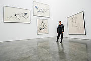 Tracey Emin with three of the embroidered images from 9x9x9 - The Last Great Adventure is You - a new exhibition at the White Cube gallery.  It is her first at the London gallery in five years and features: bronze sculptures - including In Grotto (2014), Bird (2014) and a series of bronze bas relief plaques that portray figures; gouaches; paintings; large-scale embroideries; and neon works - including one of the exhibition title. The exhibition 'chronicles the contemplative nature of work'.