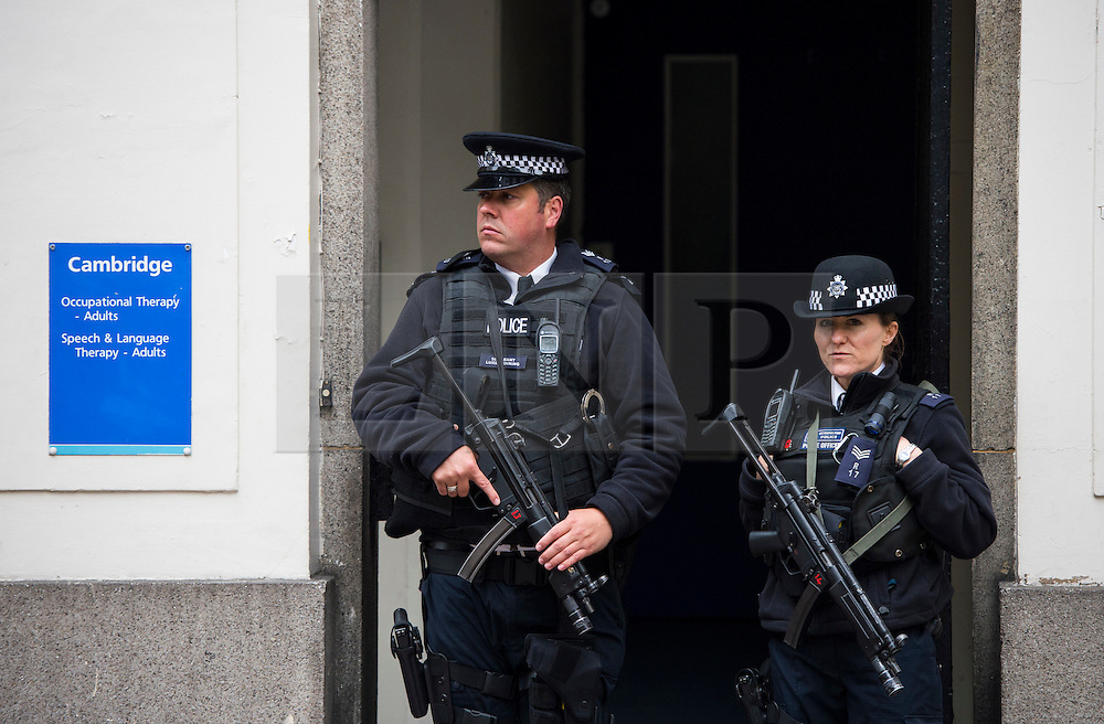 © London News Pictures. 02/05/2015. Armed Police stand outside the hospital before Catherine Duchess of Cambridge and Prince William leave the Lindo Wing of St Mary's hospital in London holding their new born baby daughter, Princess of Cambridge. Photo credit: Ben Cawthra /LNP