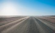 endless road in the Namibian desert safari, Namibia