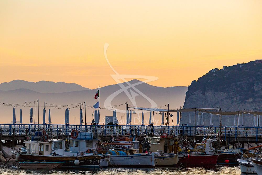Sorrento, Italy, September 16 2017. Fishing boats rest on their moorings at dawn in Marina Grande, Sorrento, Italy. © Paul Davey