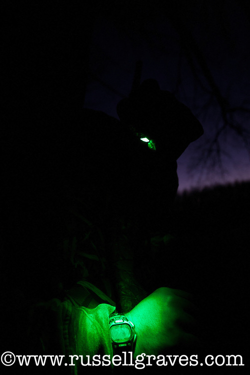 duck hunter checking the time with his green lamp