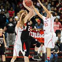 031414  Adron Gardner/Independent<br /> <br /> Shiprock Chieftain Tanisha Begay (23), right, stuffs Portales Ram  Kambrey Blakey (23) in the final moments of the championship 3A girls  high school basketball game at The Pit in Albuquerque Friday.  Begay was called for a foul on the play.
