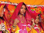 Muslim Cham girls wearing yellow robes, handwoven red cloths and bronze and copper jewellery at their Karoh (maturity) ceremony in Van Lam, Ninh Thuan province, Central Vietnam. Cham girls usually in groups of around 5, undergo a Karoh (maturity) ceremony, one of the most important ritual events of their lives and if it has not taken place, the girl cannot marry. The Cham, a Muslim community of around 39,000 people living along the coast of Central Vietnam are one of the 54 ethnic groups recognised by the Vietnamese government.