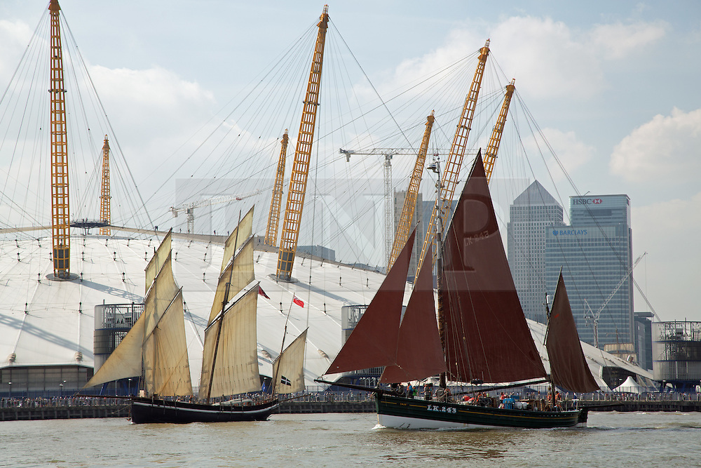 © Licensed to London News Pictures. 09/09/2014. Fifty tall ships have formed a stunning Parade of Sail down the Thames today in a dramatic and thrilling finale to the Royal Greenwich Tall Ships Festival. The ships mustered at Limehouse before moving down the Thames to the delight of onlookers, passing landmarks such as the Old Royal Naval College, the O2 and the Thames Barrier. Credit : Rob Powell/LNP