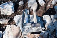 Stonemason's tools, during building of a dry stone wall in the village of Kosovelje, Kras (Karst) region, Slovenia © Rudolf Abraham