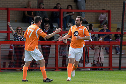 © Licensed to London News Pictures . 02/08/2015 . Droylsden Football Club , Manchester , UK . Former Sunderland footballer NEIL WAINWRIGHT congratulates DANNY DYER on scoring . Celebrity football match in aid of Once Upon a Smile and Debra , featuring teams of soap stars . Photo credit : Joel Goodman/LNP