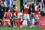 Alexis Sanchez of Arsenal (2nd left) celebrates with his teammates after he scores his teams 2nd goal in the 1st period of extra time. The Emirates FA Cup semi-final match, Arsenal v Manchester city at Wembley Stadium in London on Sunday 23rd April 2017.<br /> pic by Andrew Orchard,  Andrew Orchard sports photography.