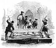Torturing a prisoner on the rack in sixteenth century England. Engrav ing c1890.