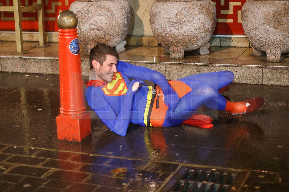 © licensed to London News Pictures. London, UK 01/01/2014. A reveller dressed as Superman in Soho, London celebrating the New Year at the first hours of 2014. Photo credit: Tolga Akmen/LNP
