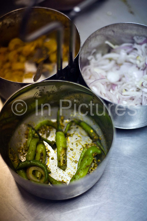 A side dish of onions and chillies at Sitaram chole bhature wala, Delhi, India A detail of bhature at Sitaram chole bhature wala, Delhi, India .The shop, originally a hand cart was started by the present owners grandfather, Diwan Chand who arrived penniless from Pakistan. The shop is reckoned to serve the finest chole bhature in Delhi.