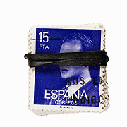 Spanish stamps held by rubber band