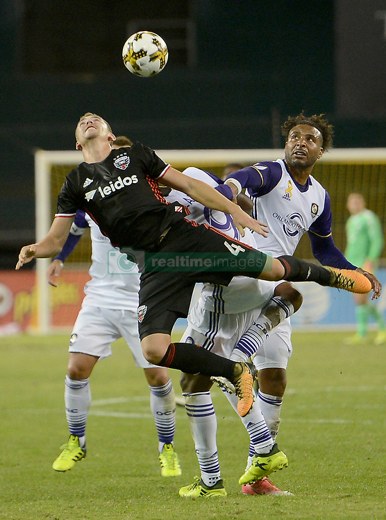 September 9, 2017 - Washington, DC, USA - 20170909 - D.C. United midfielder RUSSELL CANOUSE (4) makes a leaping attempt at the ball against Orlando City FC forward CYLE LARIN (9), right, in the second half at RFK Stadium in Washington. (Credit Image: © Chuck Myers via ZUMA Wire)